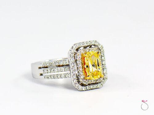 Natural Fancy Intense Yellow Diamond Ring, 1.02 ct. 18K White Gold 1.40 CTW. GIA 3