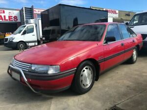 1989 Holden Commodore VN Red 4 Speed Automatic Sedan
