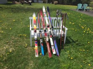 5 pairs of skis and 3 pairs of poles