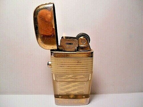 VINTAGE SCRIPTO VU GOLD TONE SMALL LIGHTER WHITE BAND WITH FANCY SYMBOLS