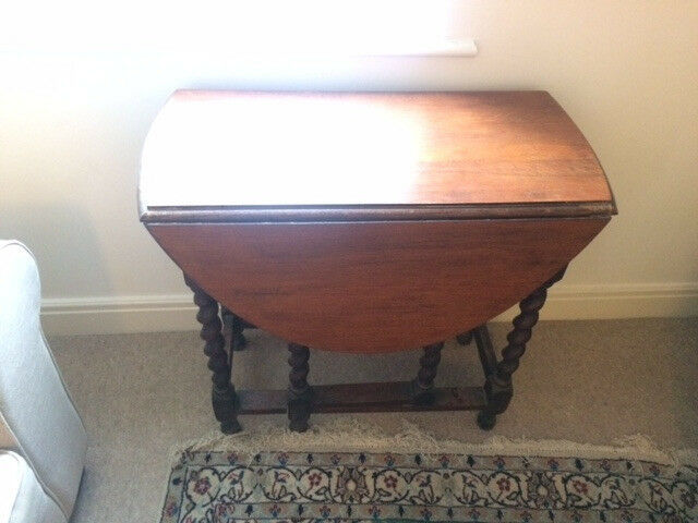 Small extendable antique style dining table