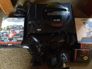 Sega Genesis 16 bit with controllers and 4 games