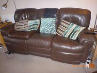 Three seat brown leather sofa