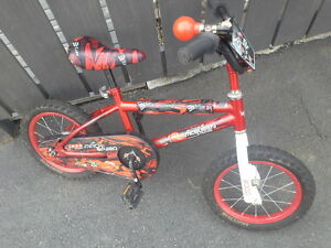 "Lightning McQueen bike w/14"" tires and helmet! (Carbonear)"