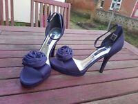 Purple heels size 4