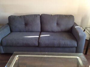 couch, chair, glass coffee and end tables and lamps