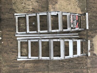 A PAIR OF MASTER MECHANIC CAR RAMPS. 1000Kg CAPACITY. NEVER USED.