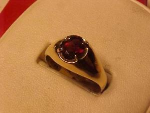 #1124-NICE DRESS RING-SIZE 11-GARNET-10K YELLOW GOLD-FREE SHIPPING IN CANADA ONLY-LAYAWAY AVAILABLE
