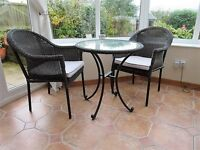Wicker table and chairs set for conservatory or patio. Table 67cm diameter. Used but as new.