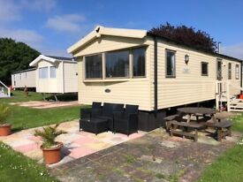 Reduced for quick sale 2013 three bedroom caravan at hopton holiday village