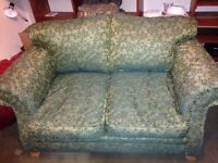 GREEN TWO-SEATER SOFA FREE TO A GOOD HOME