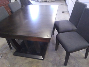 Dining room table with leaf and 4 grey material chairs