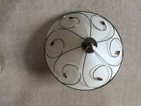 Cream ceiling light shade with brass design