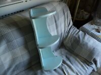 a wooden corner shelf painted in light blue ready to hang