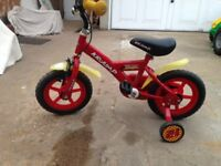 For sale a child's toy bicycle with removable stabilisers in near new condition