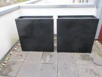 Two black tall trough fibreglass planters