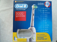 New Oral B 5000 electric toothbrush professional starter kit