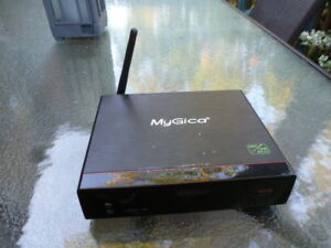 MyGica ATV1200 android streaming box with AC adaptor and remote