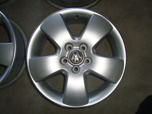 VW 15 inch alloy rims, four 195 65 15 in snow tires.