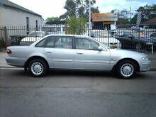 1997 Ford Fairlane NL Ghia Silver 4 Speed Automatic Sedan Tighes Hill Newcastle Area Preview