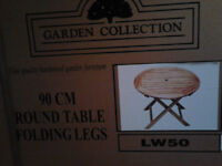 Brand new hardwood garden table and four chairs
