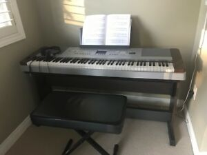 Yamaha Piano Keyboard (includes bench and pedal attachment)
