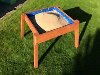 Small wooden sand pit.