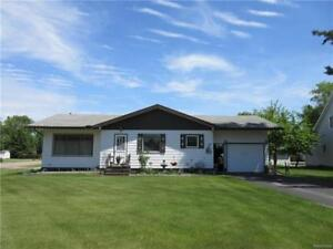 Open concept 3 BR home with garage & landscaped back yard!