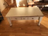 large solid white distressed wood coffee table with 3 drawers