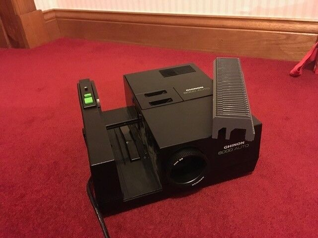 Chinon Slide Projector with spare magazines, bulbs and instructions bought 1979 good working order