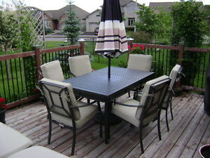 Powder-coated Steel Patio Set by Gluckstein Home.