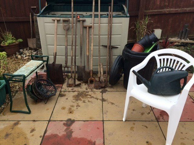 Assortment of garden tools: spades, forks, hoes, stool, chair - REDUCED