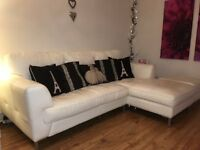 White leather 3 seater chaise longue sofa with matching footstool.