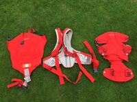 Stokke MyCarrier, front and back baby carrier, red.