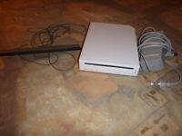 Console Wii avec 5 manettes et 13 jeux a vendre