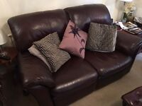 2 seater sofa brown leather excellent condition - one recliner - bargain
