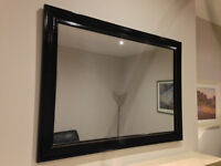 Medium sized black framed mirror