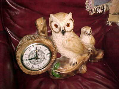 LARGE OWL WALL HANGING CLOCK VERY UNUSUAL ELECTRIC AND WORKS AS IT SHOULD HEAVY