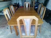 Extending solid wood dining table and 6 matching chairs set