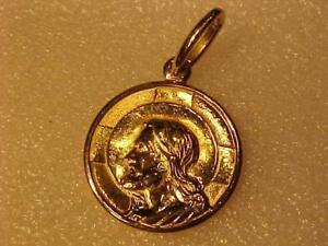 #3421-A lovely Solid 18k yellow gold pendant of **OUR LORD** Nice weight..Hallmarked .750-I will ship free in Canada