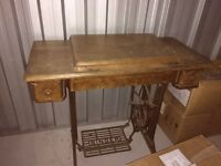 Antique Singer sewing machine and table.