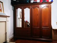 large mirrored bedroom wardrobe with lock and key