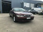 1997 Ford Fairmont EL Maroon 4 Speed Automatic Sedan Newport Hobsons Bay Area Preview