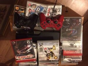 Playstation 3 with two paddles and 13 games