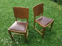 Dining chairs x 2, leather look seats.