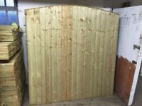 Bow top feather edge fence panels pressure treated green