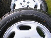 4 New Bridgestone Blizzak WS70 snow tires with rims.