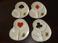4 small ashtrays and matching cigarette lighter