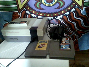 NES for sale, includes all wires,one controller,two games