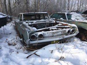 Demolition derby cars, trucks and parts.